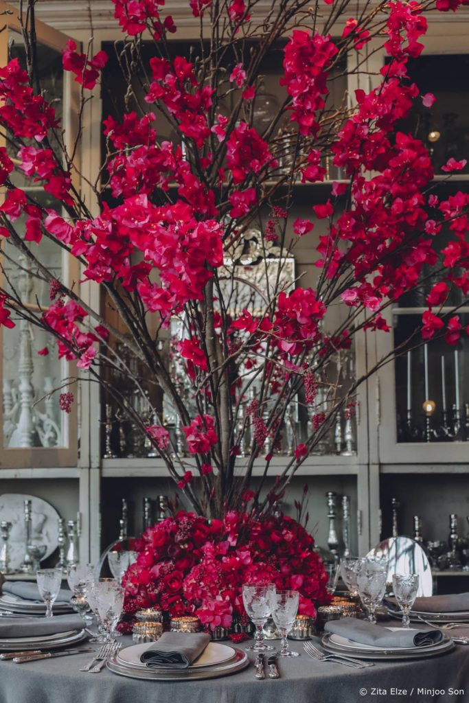 Rouge bougainvillea table centrepiece by Zita Elze wedding flowers photo Minjoo Son