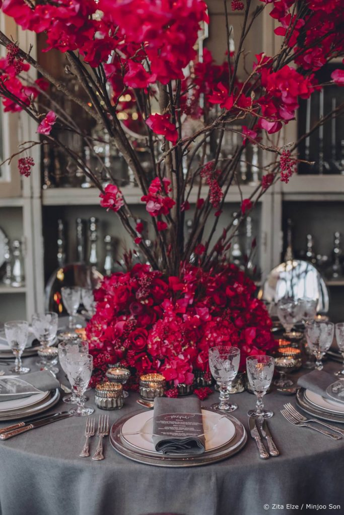 Rouge bougainvillea, rose, tulip and ranunculus floral table centrepiece by Zita Elze wedding flowers photo Minjoo Son