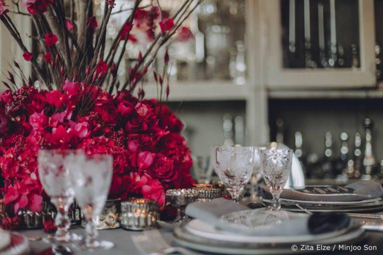 Hot pink and rouge floral centrepiece by Zita Elze Wedding Flowers, photo: Minjoo Son